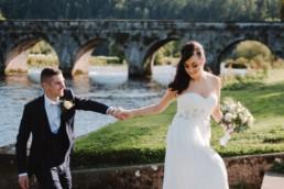 groom and bride walking in inistioge muncipal park